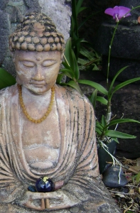 Buddha upper body w flower
