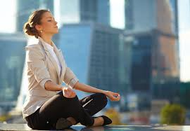 city woman meditating