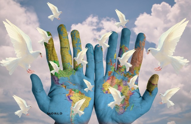 world-hands w doves pixabay